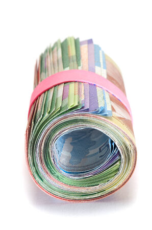 Front view of a Roll of Canadian banknotes wraped with a pink rubber band photo