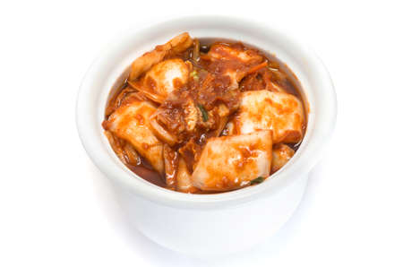 korean cuisine, fermented food Kimchi on white ceramic bowl photo