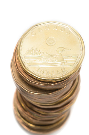 canadian coin: One Canadian dollar coins stack on white