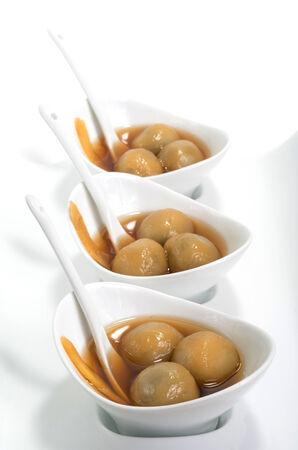 Vietnamese glutinous rice balls dessert on white  photo