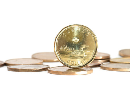 purchase: One Canadian dollar coins stack on white