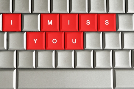 miss you: I miss you spelled on metallic keyboard