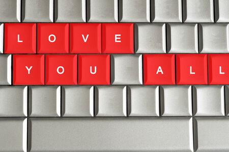 all love: Love you all  spelled on metallic keyboard