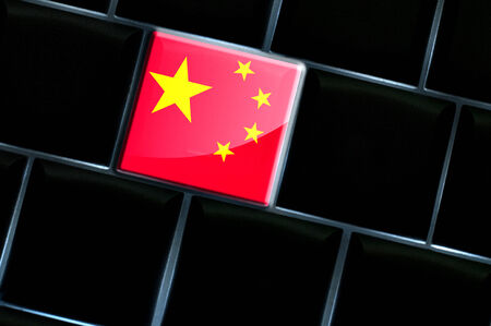 backlit keyboard: Chinese online concept with flag over the backlit keyboard Stock Photo