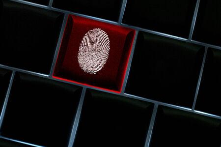 red handed: Online crime scene concept with the fingerprint left on a backlit keyboard