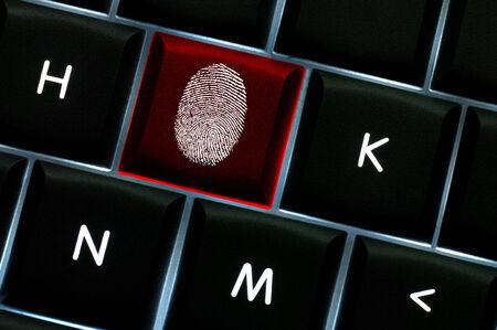 Online crime scene concept with the fingerprint left on a backlit keyboard
