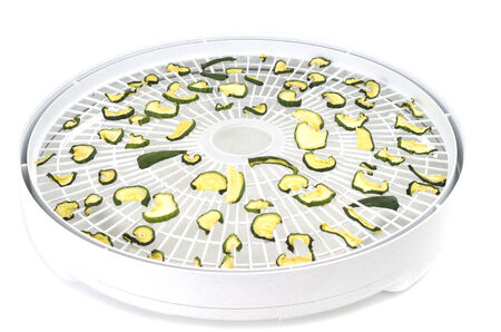Dehydrated cucumber slices on food dehydrator tray