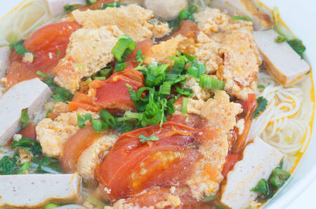Bun Rieu Meat rice vermicelli soup, served with tomato broth and topped with crab paste photo