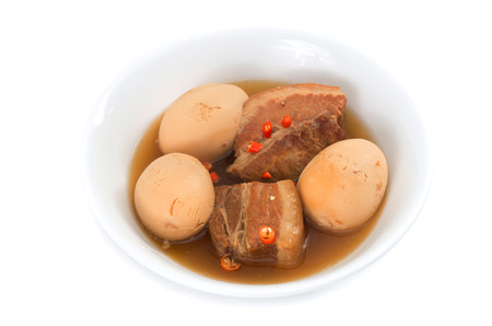 Thit Heo Kho Trung  Vietnamese caramelised pork belly with hard-boiled eggs braised in coconut water photo