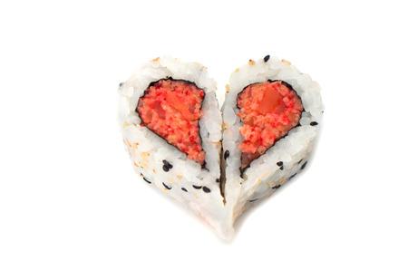 Sushi forming heart shape on white