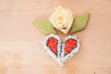 Sushi forming hearts and flower shapes photo