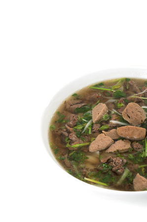 Vietnamese food , rice noodle soup with sliced sauteed beef and meat ball  photo