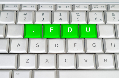Internet top level domain .edu spelled on metallic keyboard photo