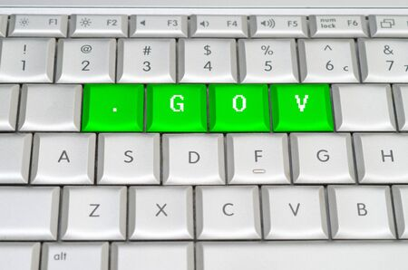 Internet top level domain .gov spelled on metallic keyboard photo