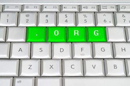 Internet top level domain .org spelled on metallic keyboard 免版税图像