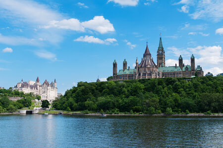 Canadian Parliament Hill viewed from across Ottawa river during a beautiful summer day photo