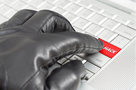 scamming: Online hacking concept with hand wearing black glove  Stock Photo