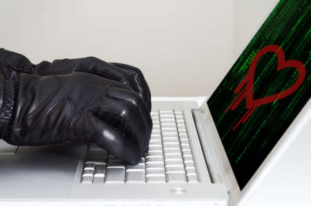 exploit: Heartbleed exploit concept with hands wearing black gloves Stock Photo
