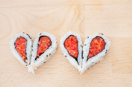 Love sushi concept with four pieces of sushi forming the two hearts  photo