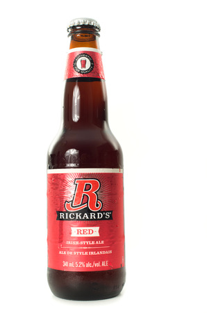molson: MONTREAL, MAY 16,2014: Bottle of 341ML Rickards Red beer produced by Molson Coors Canada. Its Canada favorite pub red beer.