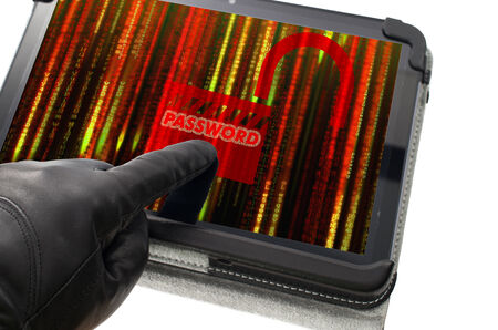 pirated: Unlocking password concept with hand wearing black glove pointing a tablet screen
