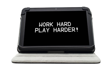 harder: Work hard play harder typed on a tablet screen Stock Photo