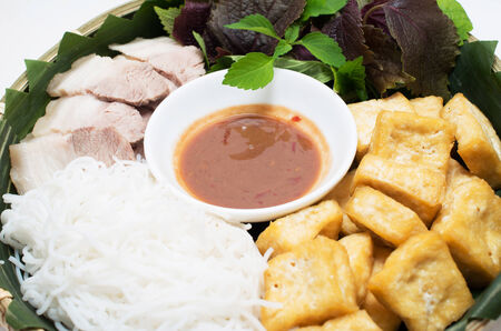 Vietnamese traditional plate pork vermicelli  tofu and vegetable in bamboo plate