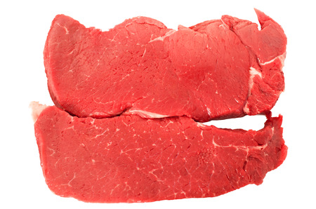 Two raw beef steaks isolated on white background