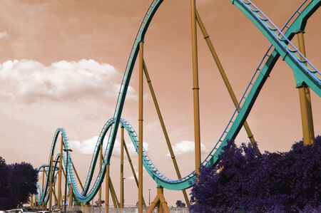 looping: Wide angle view roller coaster track applied with vintage and artistic filter  Editorial