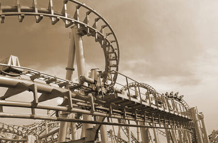 Wide angle view roller coaster track with sepia tone applied