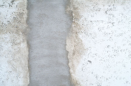 botched: Rough, botched, putty, cement wall