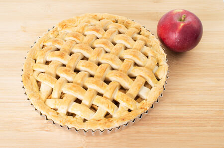 Baked apple pie against wooden background Stock Photo