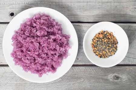 Vietnamese Magenta leaves sticky rice and dipping plate - Xoi la cam photo