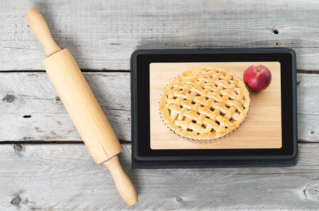 blank tablet: On-line bakery concept with a touch screen tablet and rolling pin