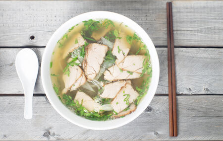 Vietnamese vermicelli pork soup - Mien heo - Tet traditional meal photo