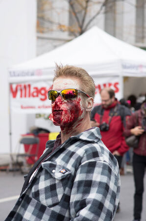 MONTREAL, QUEBEC, CANADA - OCTOBER 25 - Montreal Zombie Walk, La Marche Des Zombies edition 2014. A zombie walk is a public manifestation, where participants walk around dressed as zombies and have zombie makeup - 20141025 Editorial