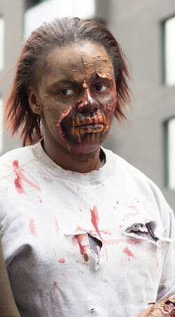 MONTREAL, QUEBEC, CANADA - OCTOBER 25 - Montreal Zombie Wal. A zombie walk is a public manifestation, where participants walk around dressed as zombies and have zombie makeup - 20141025