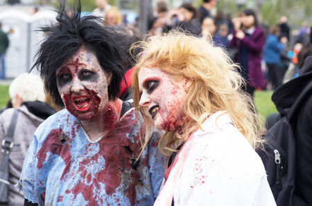 MONTREAL, QUEBEC, CANADA - OCTOBER 25 - Montreal Zombie Walk. A zombie walk is a public manifestation, where participants walk around dressed as zombies and have zombie makeup - 20141025