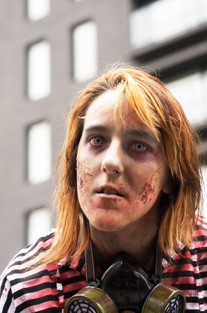 MONTREAL, QUEBEC, CANADA - OCTOBER 25: Participants walk around dressed as zombies and have zombie makeup at Montreal Zombie Walk on October 25, 2014 in Montreal.