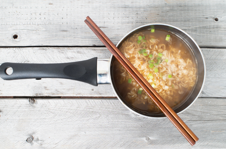 cooked instant noodle: Asian instant noodle cooked in a saucepan