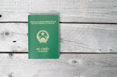 Vietnamese passport against wooden background Stock Photo - 33391195