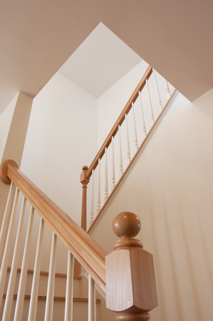 Wooden stairs and handrail viewed from bottom