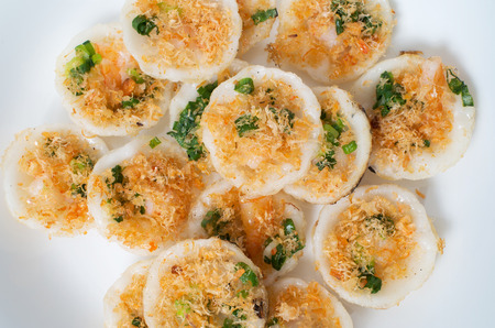 close up food: Vietnamese mini rice pan cakes garnished with shredded dried shrimps - banh khot