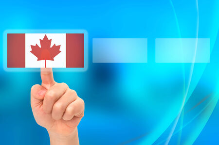 Young Asian boy hand touching button selecting Canadian option