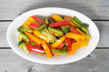 Vietnamese Stir Fry Vegetables on a wooden table Stock Photo
