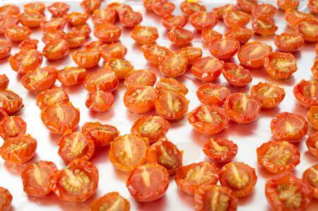 sundried: Sun-dried cherry tomatoes on an aluminum sheet