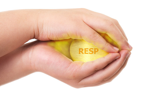 Canadian Registered Education Savings Plan, RESP concept with two hands holding tight on a golden egg