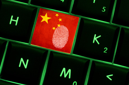 warrant: Online crime scene with a finger print left on backlit keyboard with Chinese flag on it
