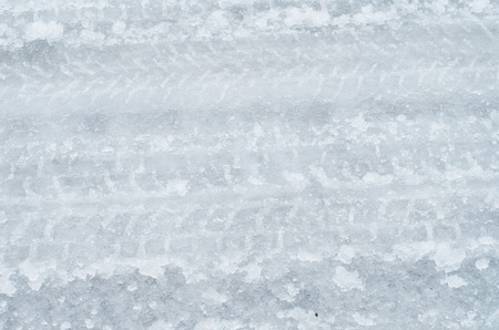winter road: Close up of tire tracks on icy road