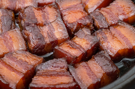 Vietnamese caramelized pork belly in clay pot photo